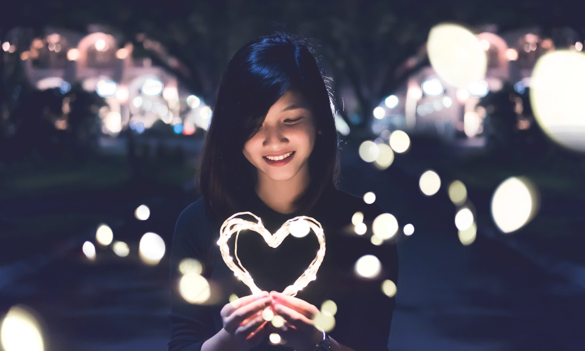 Happy woman with glowing heart